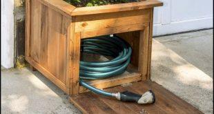 Build a garden hose storage with planter!