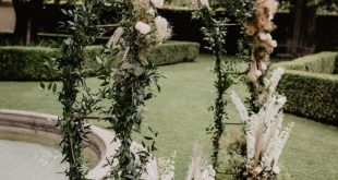This stunning ceremony archway features greenery + pampas grass for a garden-ins... #archway...